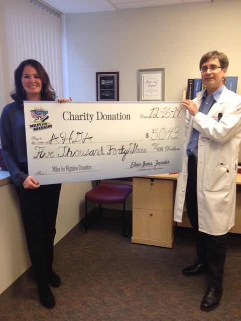 Shirley Kessel, Philadelphia Miles for Migraine Chairperson presents Bill Young, MD, AHDA President with a generous donation on behalf of Miles for Migraine.